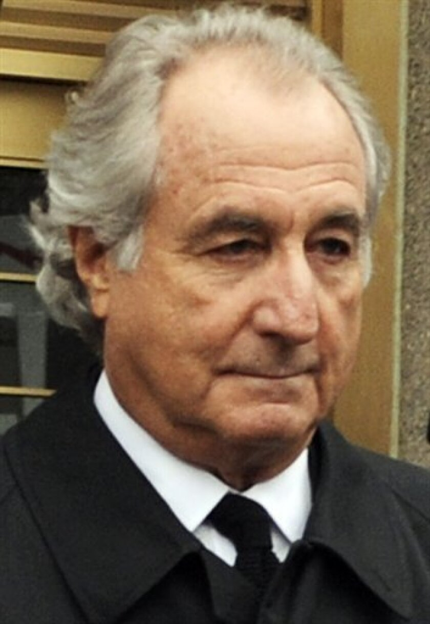 FILE - In this March 10, 2009 file photo, Bernard Madoff exits Manhattan federal court in New York. A federal judge has ordered disgraced financier Bernard Madoff to forfeit over $170 billion, Friday, June 26, 2009. (AP Photo/Louis Lanzano, File)