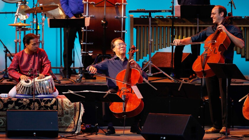 Yo-Yo Ma, flanked by Sandeep Das and Mike Block, perform as the Silk Road Ensemble on Sunday at the Hollywood Bowl.