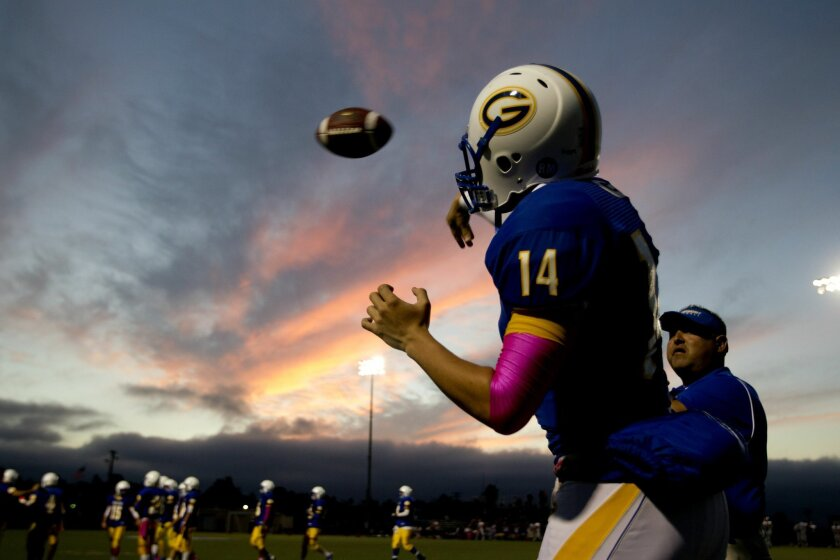 Grossmont quarterback Anthony Lawrence warms up before the start of the game against Valhalla.