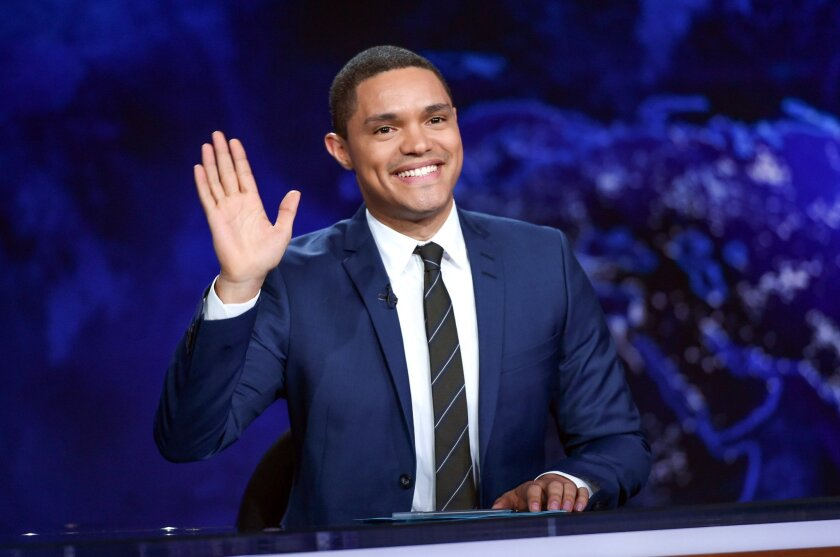 "FILe - In this Sept. 29, 2015 file photo, Trevor Noah gestures on the set during a taping of ""The Daily Show with Trevor Noah"" in New York. One day after an emergency appendectomy, Trevor Noah was expected back at his ""Daily Show"" anchor desk, taping a new episode set to air Thursday night.  (Photo"