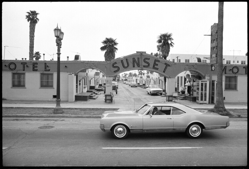 """Sunset Blvd.,"" 1966, by Ed Ruscha. A vintage car driving before the Sunset Motel"