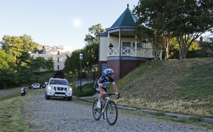 FILE - In this May 20, 2015, file photo, cyclist Mark Cavendish, of Britain, makes his way up Libby Hill during his test ride of the 2015 UCI Road World Championships Road Course. The event, featuring 12 Championship races for Elite Men and Women, Under 23 Men and Junior Men and Women, will be held