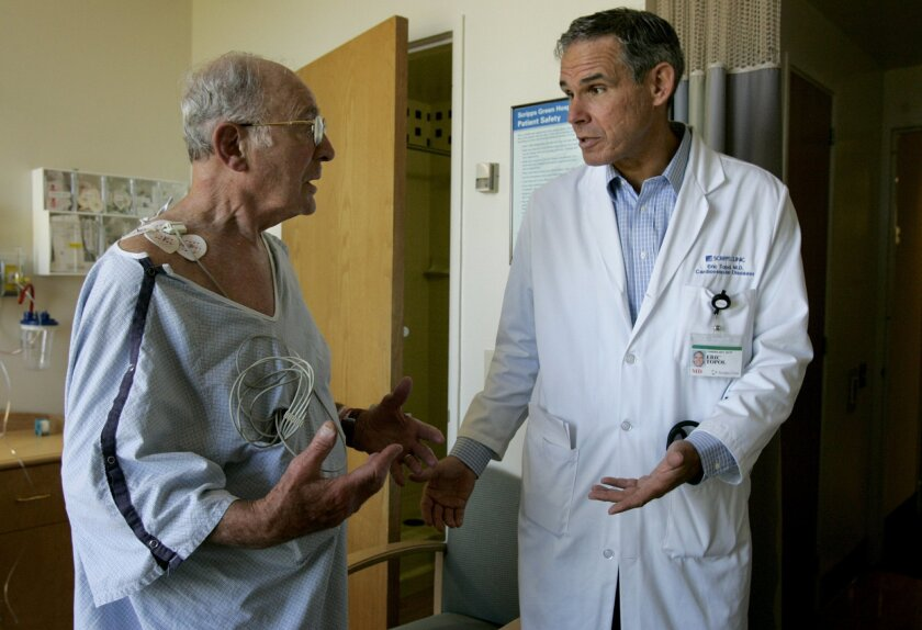 Dr. Eric Topol, director of Scripps Translational Science Institute in La Jolla, consults with a patient.