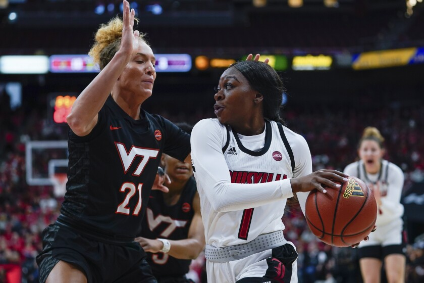 Louisville guard Dana Evans (1) drives toward the basket around Virginia Tech forward Lydia Rivers (21) during the first half of a women's NCAA college basketball game, Saturday, March 1, 2020, at the KFC YUM Center in Louisville, Ky. (AP Photo/Bryan Woolston)