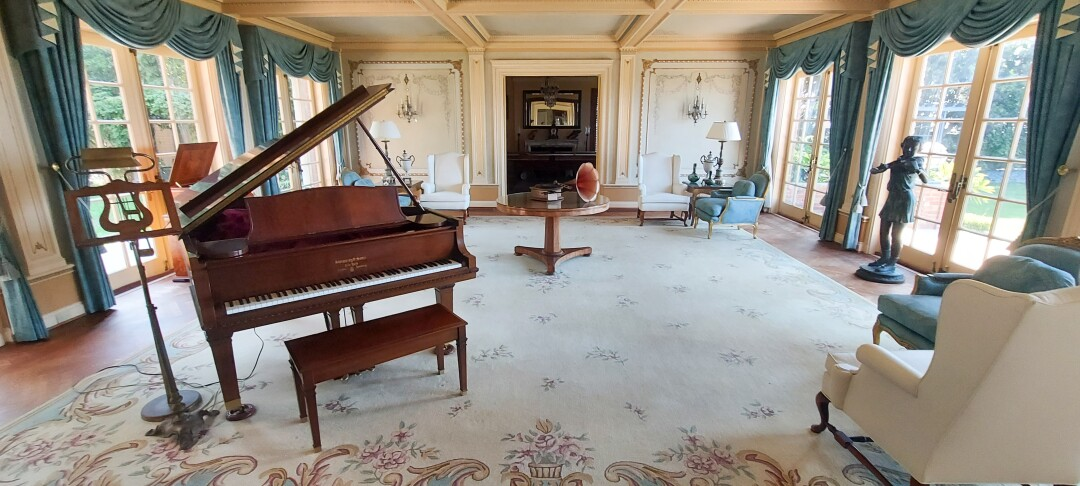 This large space includes a piano and early 1900's music players at Crown Manor in Coronado.