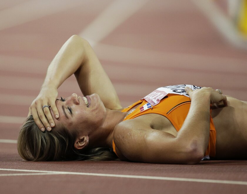 Dafne Schippers of the Netherlands celebrates winning the women's 200m final at the World Athletics Championships at the Bird's Nest stadium in Beijing, Friday, Aug. 28, 2015. (AP Photo/David J. Phillip)