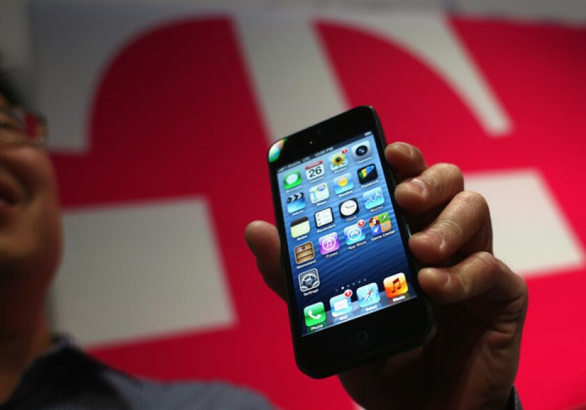"An iPhone 5. The Wall Street Journal is reporting that the next iPhone will be ""similar in size and shape"" as the iPhone 5."