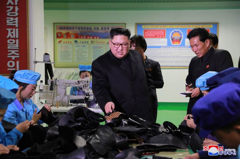 North Korean leader Kim Jong Un visits a shoe factory in Wonsan in a photo released by North Korea's official Korean Central News Agency in December