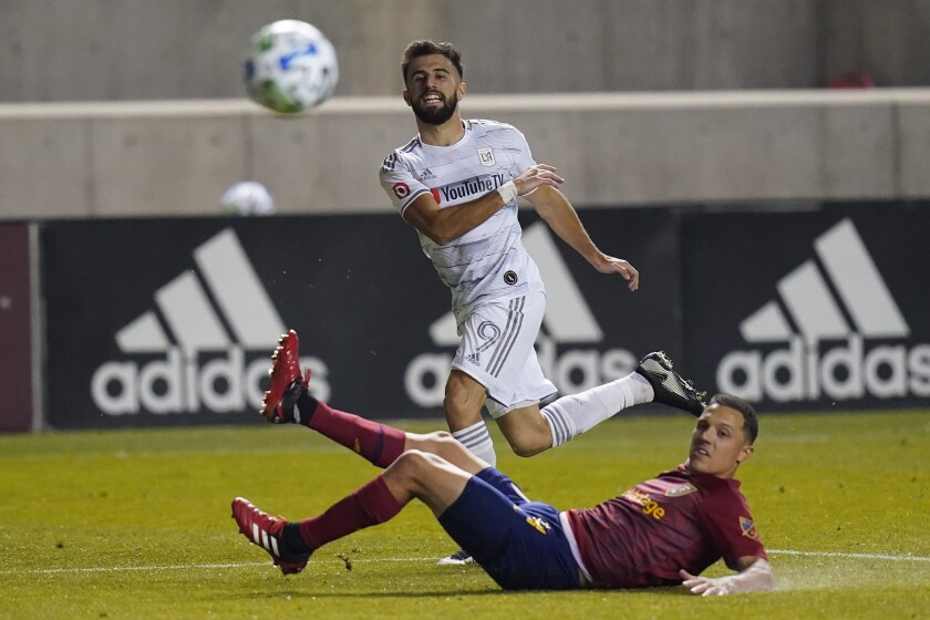 LAFC forward Diego Rossi passes the ball in front of Real Salt Lake defender Donny Toia.