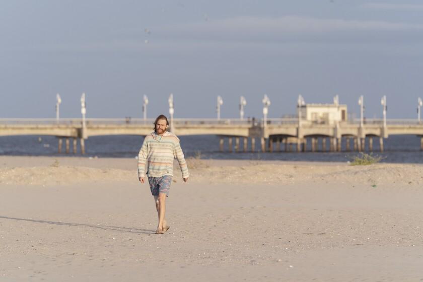 "Wyatt Russell walks the beach in ""Lodge 49"""