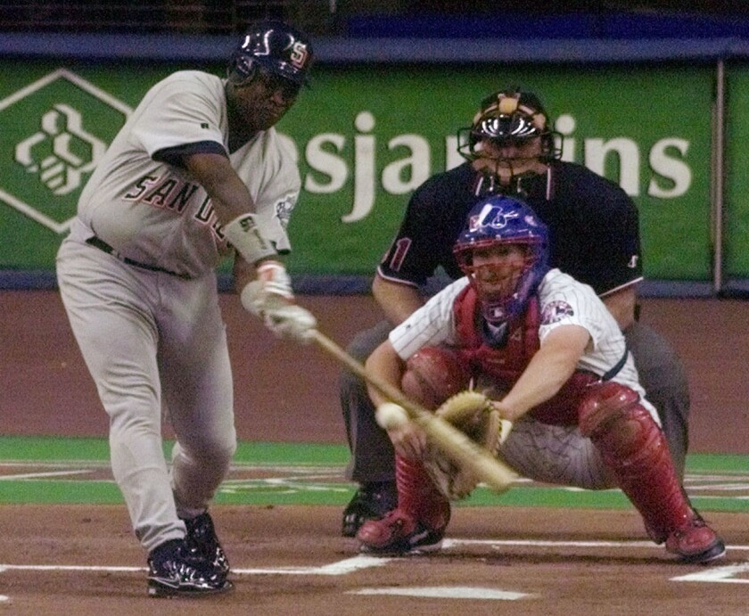 The Padres' Tony Gwynn gets his 3,000th career hit in the first inning against the Montreal Expos in 1999 in Montreal.