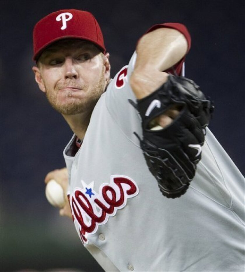 Philadelphia Phillies starting pitcher Roy Halladay delivers a pitch against the Washington Nationals during the first inning of a baseball game Monday, Sept. 27, 2010, in Washington. (AP Photo/Evan Vucci)