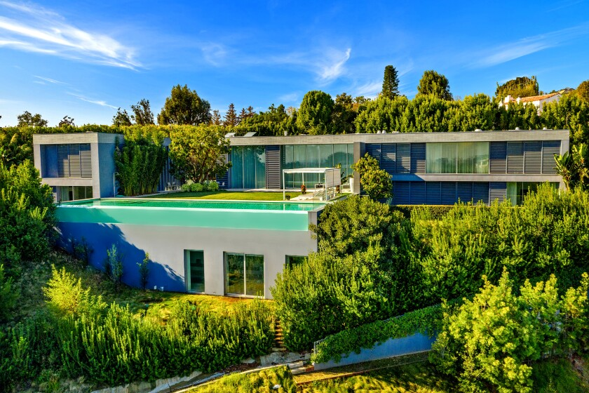The 14,000-square-foot showplace sits on over an acre above Bel-Air Country Club, taking in views of the golf course and the city beyond.