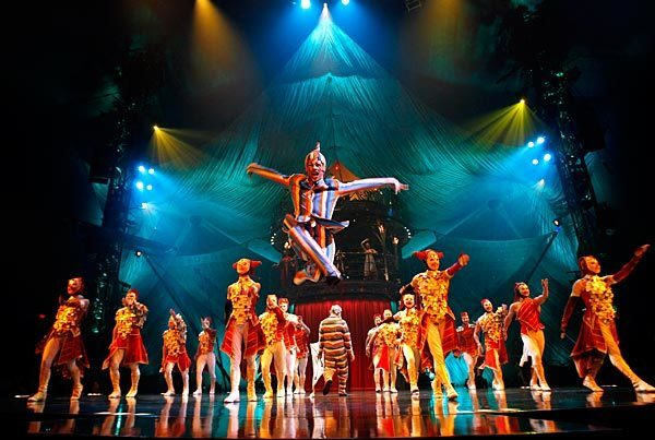 """Mike Tyus, portraying a trickster character, leads performers into the ring in Cirque du Soleil's traveling production of """"Kooza,"""" being presented through Nov. 29 under a big top adjacent to the Santa Monica Pier."""