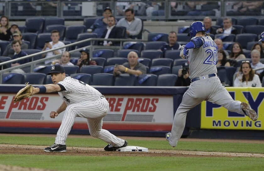 New York Yankees first baseman Mark Teixeira takes the throw to first for the out on a bunt by Toronto Blue Jays Josh Donaldson during the third inning of a baseball game, Tuesday, May 24, 2016, in New York. (AP Photo/Julie Jacobson)