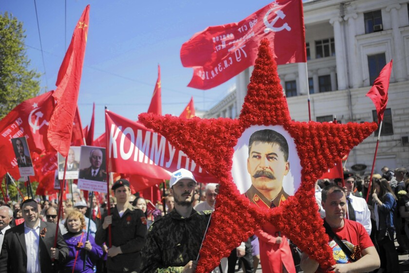 Marchers carry a portrait of Josef Stalin in Sevastopol, Crimea, on May 9 as they mark the 70th anniversary of the end of World War II.