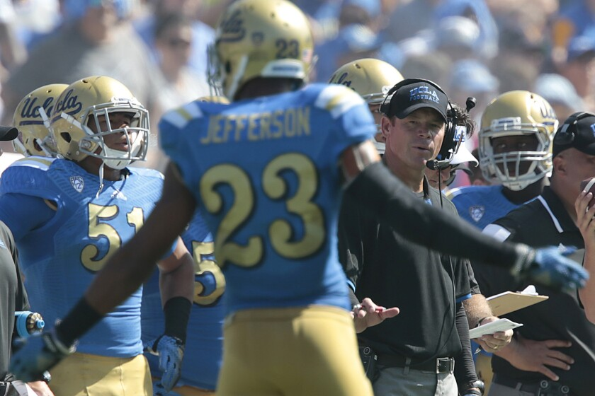 UCLA Coach Jim Mora encourages defensive back Anthony Jefferson to keep his cool after a teammate was called for a penalty early in the game against Oregon at the Rose Bowl on Oct. 11, 2014.