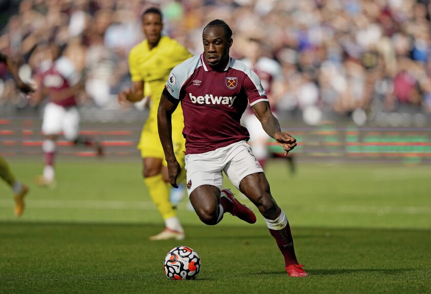 West Ham United forward Michail Antonio (9) moves the ball up the pitch during an English Premier League soccer match against Brentford at London Stadium in London, Sunday, Oct. 3, 2021. (AP Photo/Steve Luciano)