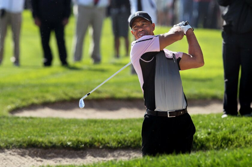 Day 1 of Farmers Insurance Open at Torrey Pines- SOUTH COURSE, Tiger Woods shoots from a fairway sand trap on hole 6.