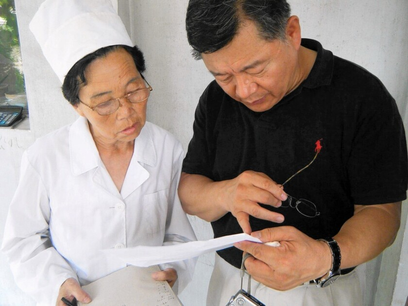 Pastor Lim Hyeon-soo, right, during a medical trip to North Korea. He is serving a sentence in a North Korean labor camp.