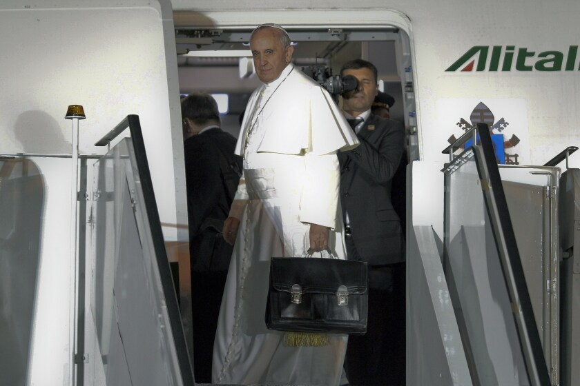 Pope Francis boards a plane Sunday night in Rio de Janeiro after concluding a weeklong trip to Brazil.