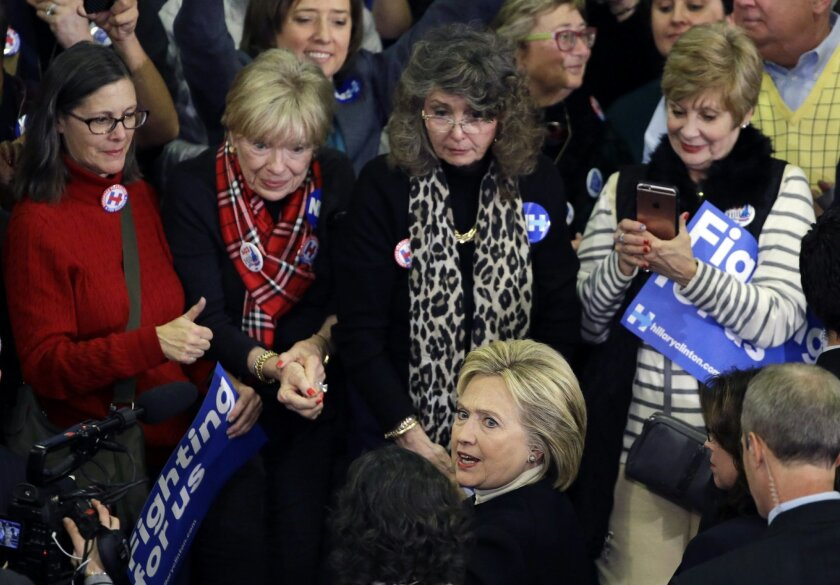 In this Feb. 9, 2016, photo, Democratic presidential candidate Hillary Clinton mingles with supporters at her New Hampshire presidential primary campaign rally in Hooksett, N.H. For young women, political revolution is currently trumping the idea of a Madame President. In New Hampshire, women under