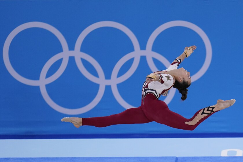 Pauline Schaefer-Betz, of Germany, performs her floor exercise routine during the women's artistic gymnastic qualifications at the 2020 Summer Olympics, Sunday, July 25, 2021, in Tokyo. (AP Photo/Gregory Bull)