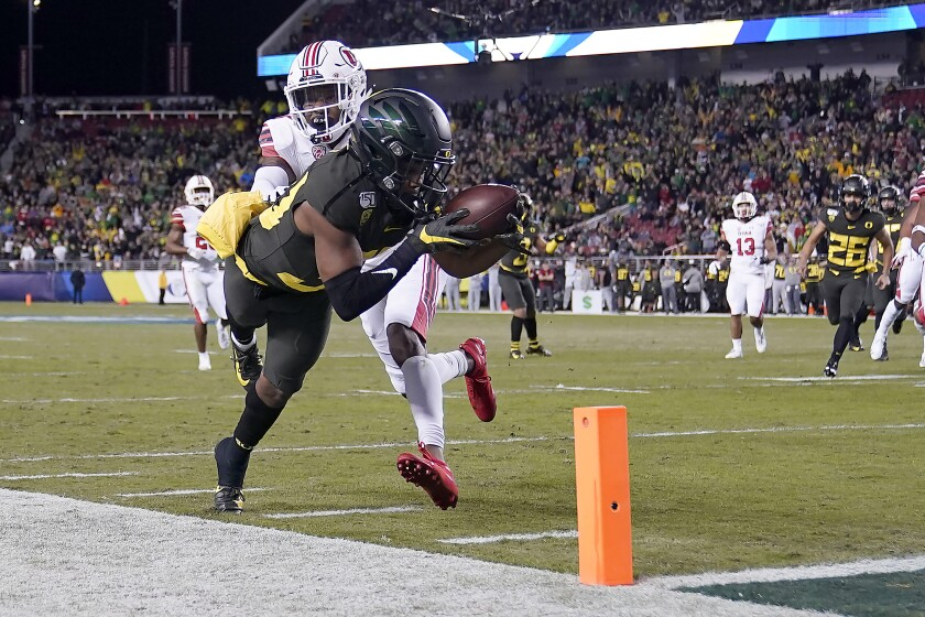 Oregon wide receiver Jaylon Redd (30) is pushed out of bounds by Utah defensive back Josh Nurse (14) short of the goal line during the first half of the Pac-12 championship game on Friday in Santa Clara.