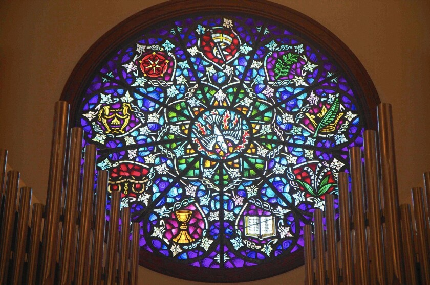 The stained-glass window at the front of St. James the Great Episcopal Church in Newport Beach was donated in memory of 8-year-old Patrick Lyon, whose family has been trying to get the window out of the closed church.