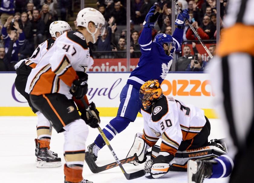 The Maple Leafs' John Tavares celebrates his overtime game winner against goalie Ryan Miller and the Ducks on Feb. 7, 2020.
