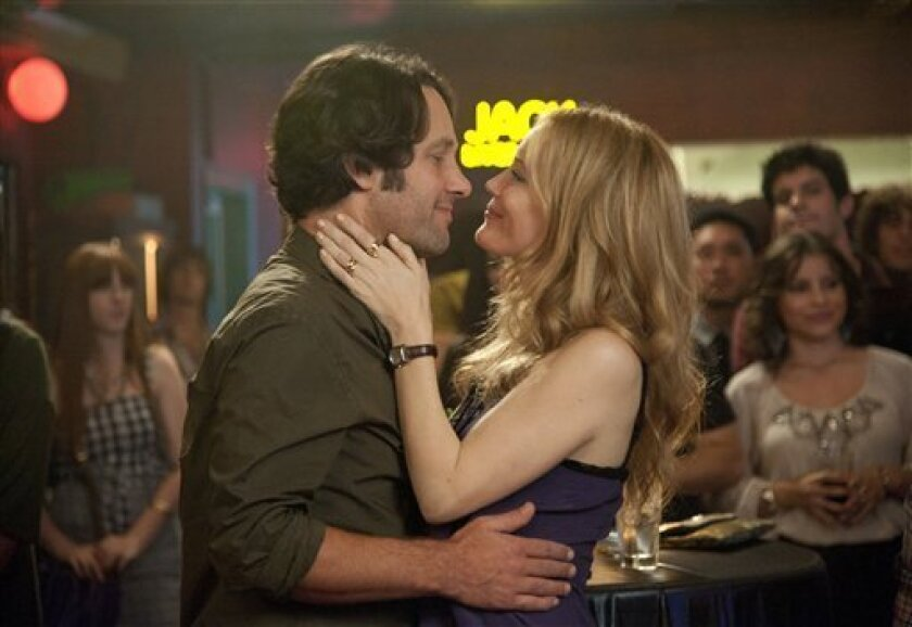 """This publicity film image released by Universal Pictures shows Paul Rudd, left, and Leslie Mann in a scene from the film, """"This is 40."""" (AP Photo/Universal Pictures, Suzanne Hanover)"""