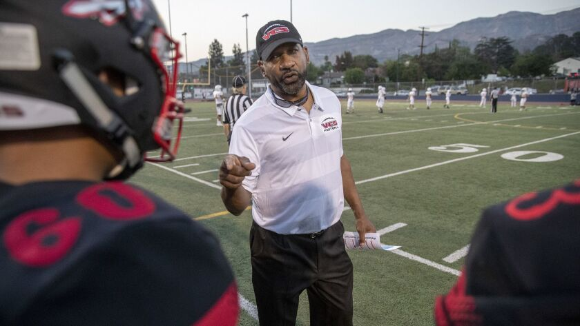 Former USC running backs coach Todd McNair on the football field at Burbank High with the Village Christian Crusaders in Burbank, on Aug. 17, 2018.