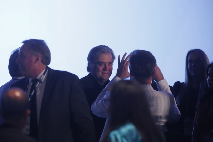 People gather around Stephen K. Bannon before he speaks at The California Republican Party convention at the Anaheim Marriott in Anaheim on Oct. 20.