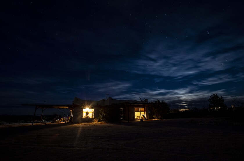 """A cloudy sky covers the moonrise at the Creosote House in Joshua Tree, part of Wild Up's """"darkness sounding"""" series."""