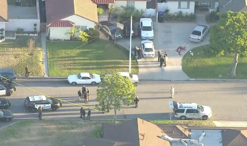 An off-duty LAPD officer shot and wounded two suspect in Downey, police said.