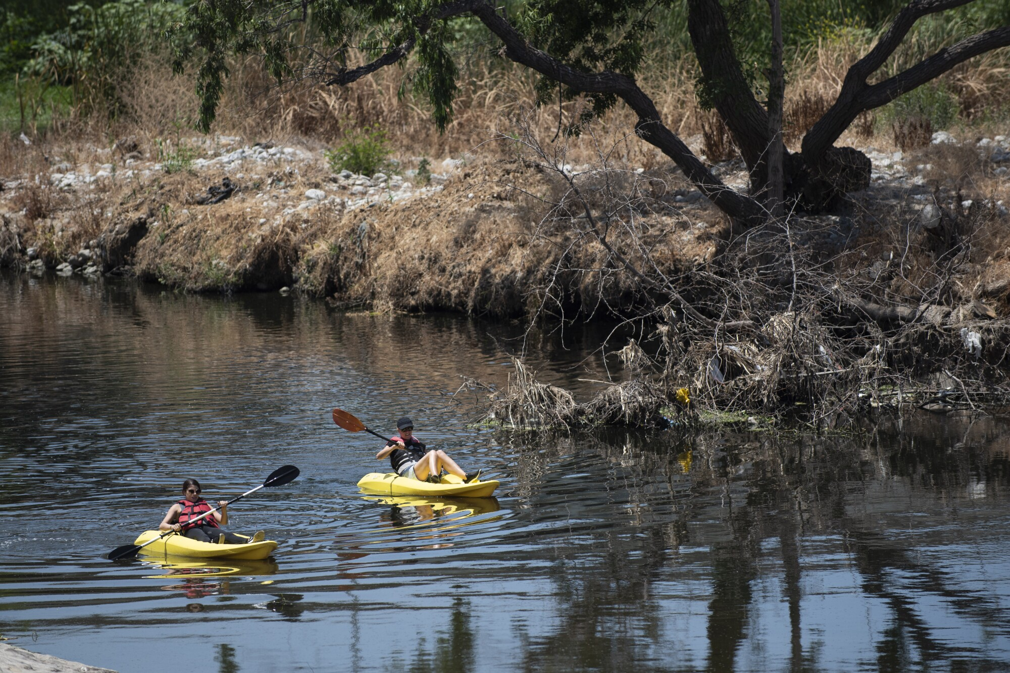 Kayakers float on the Los Angeles River in Elysian Park.