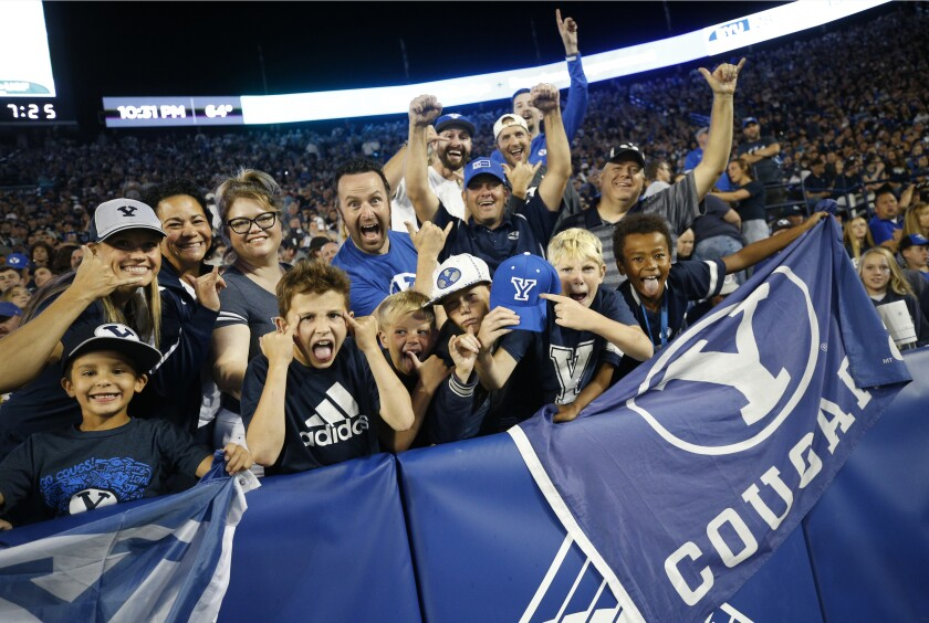 BYU fans cheer in the second half of an NCAA college football game against South Florida Saturday, Sept. 25, 2021, in Provo, Utah. (AP Photo/George Frey)