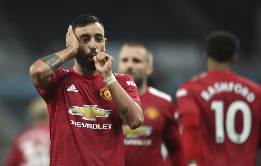 Manchester United's Bruno Fernandes celebrates after scoring the 2-1 lead during the English Premier League soccer match between Newcastle United and Manchester United at St. James' Park in Newcastle, England, Saturday, Oct. 17, 2020. (Alex Pantling/Pool via AP)