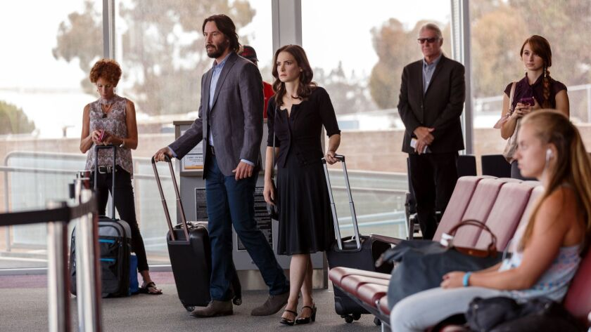 Frank (Keanu Reeves) and Lindsay (Winona Ryder) take off to the least expected place in DESTINATION