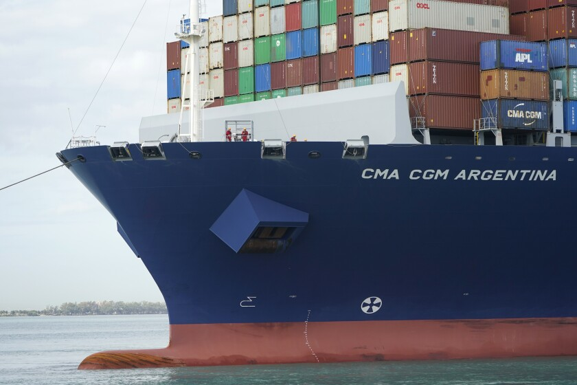 Crew members stand on the bow as the CMA CGM Argentina arrives at PortMiami