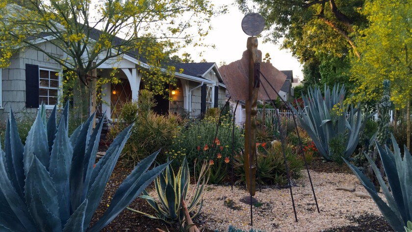 Epstein also carved out room for a 10-foot tall contemporary mixed media sculpture of an angel standing tall over a cactus garden.