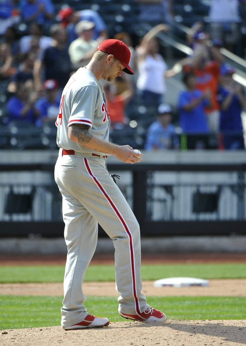 Philadelphia Phillies starting pitcher A.J. Burnett (34) reacts on the mound after New York Mets' Anthony Recker hit a three-run home run in the sixth inning of a baseball game on Sunday, Aug. 31 2014, in New York. The Mets won 6-5. (AP Photo/Kathy Kmonicek)