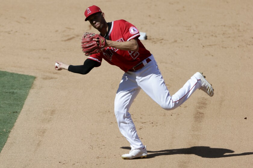 Los Angeles Angels shortstop Andrelton Simmons throws to first to get Texas Rangers' Rougned Odor out on a ground ball during the sixth inning of a baseball game in Anaheim, Calif., Sunday, Sept. 20, 2020. (AP Photo/Alex Gallardo)