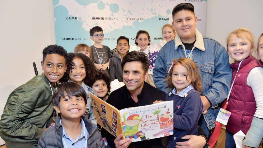 John Stamos and kids attend the Hammer Museum K.A.M.P. event May 19 in Los Angeles.