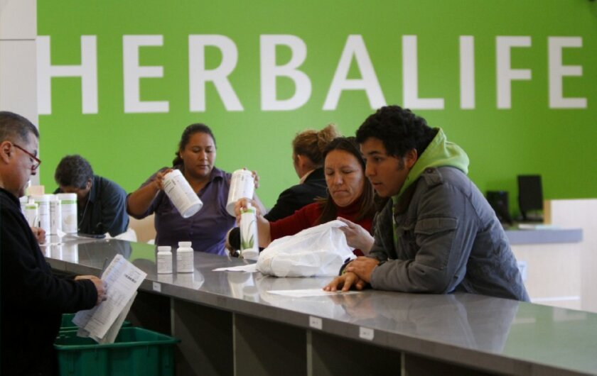 Distributors buy Herbalife products at a distribution center in Carson.