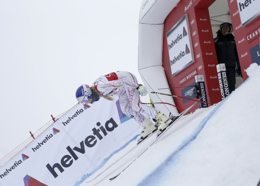 United States' Lindsey Vonn takes to the slope during an Alpine ski, women's downhill training, in Crans Montana, Switzerland, Friday, Feb. 12, 2016. (AP Photo/Gabriele Facciotti)