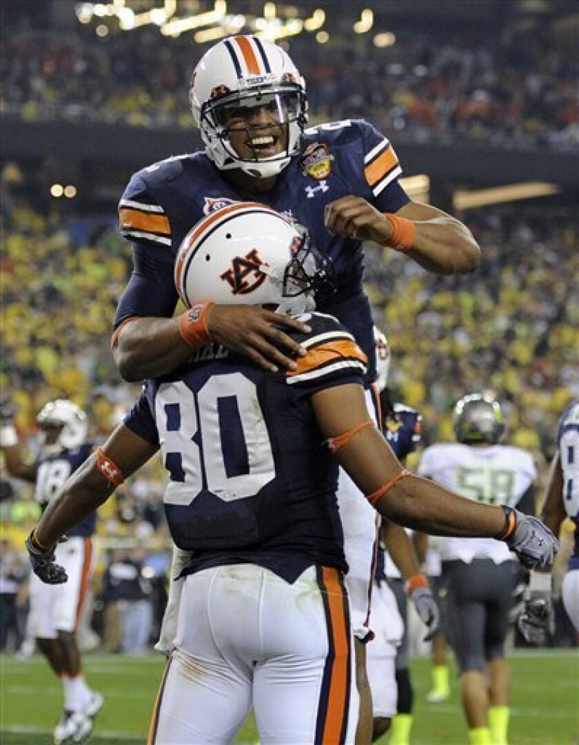 Auburn's Emory Blake (80) celebrates with Cam Newtown after scoring a touchdown during the first half of the BCS National Championship NCAA college football game against Oregon Monday, Jan. 10, 2011, in Glendale, Ariz. (AP Photo/Mark J. Terrill)