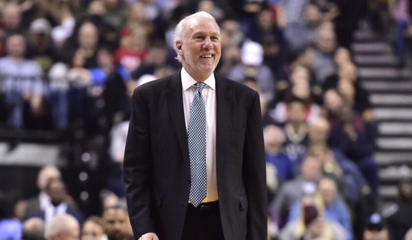 San Antonio Spurs coach Gregg Popovich smiles during a game against the Toronto Raptors in February.