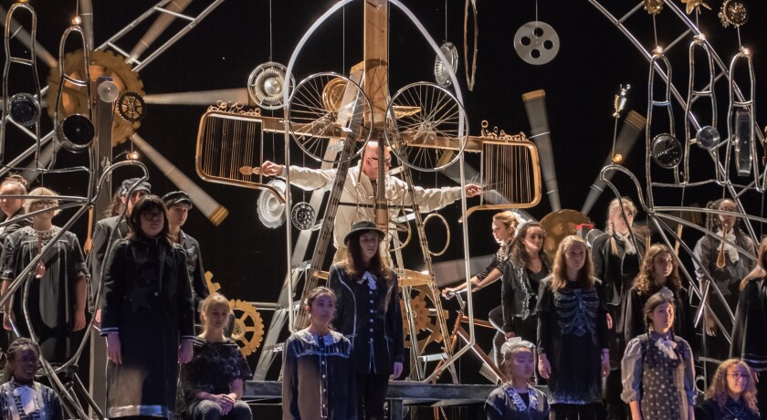 "Writer/performer Rinde Eckert, center, and the Brooklyn Youth Chorus perform in the 2016 premiere of ""Aging Magician."" The production was scheduled to open Friday in San Diego but has been canceled to due to coronavirus concerns."