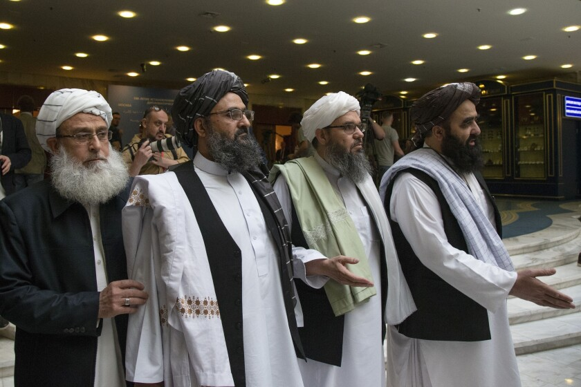 A Taliban delegation arrives for talks with Afghan politicians in Moscow in 2019.